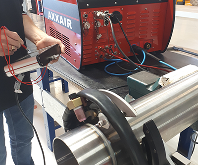 Achieving high quality welds with an orbital power supply